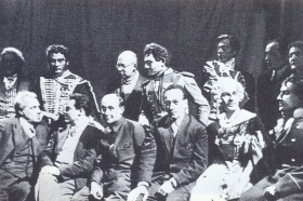 "Participants of the dress rehearsal of ""The Queen of Spades"". They sit (from left to right): V.E. Meyerhold, S.A. Samosud, S.N. Gisin, R.A. Shapiro, N.L. Welter, N.I. Kowalski. Among those standing (in the center) - LT. Chupyatov. (Участники генеральной репетиции ""Пиковой дамы"". Сидят (слева направо): В.Э. Мейерхольд, С.А. Самосуд, С.Н. Гисин, Р.А. Шапиро, Н.Л. Вельтер, Н.И. Ковальский. Среди стоящих (в центре) - Л.Т. Чупятов.) (Belyaev)"